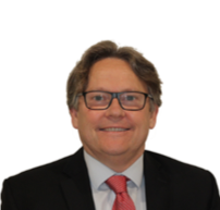 Male pharmacist wearing glasses and a red tie smiles at the camera.
