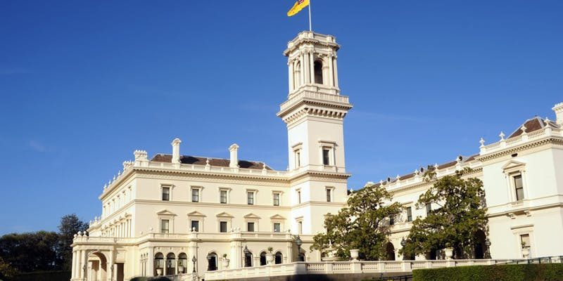 Government House, Victoria. A large cream coloured stately home with the raised Governor of Victoria flag