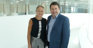 Associate Professor Kate Burbury stands next to Dr Craig Underhill. They are both smiling at the camera in the VCCC.