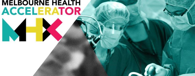 Photo of surgeons operating with the Melbourne Health Accelerator logo in the top left hand corner