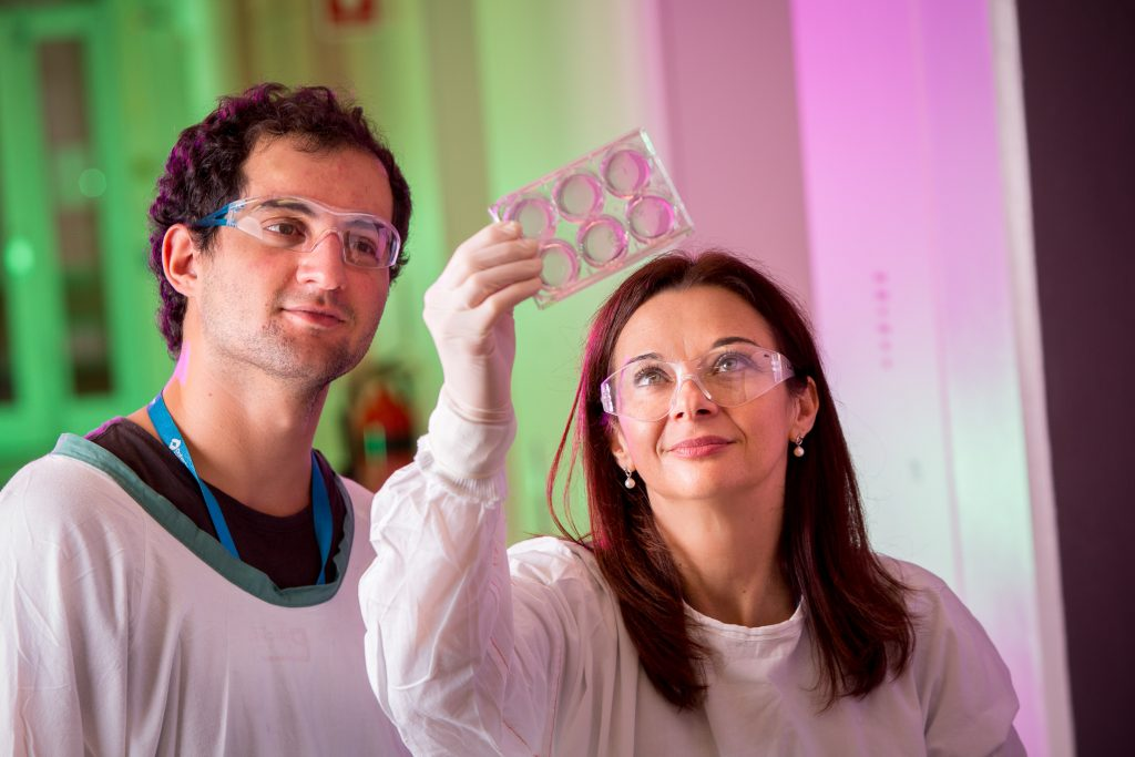 Two scientists inspect some images in the light
